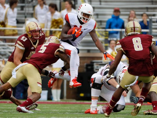 Syracuse wide receiver Amba Etta-Tawo (7) tries to leap past Boston College defensive back Kamrin Moore (5) during the second half of Syracuse's 28-20 win over Boston College at Alumni Stadium on Oct. 22.