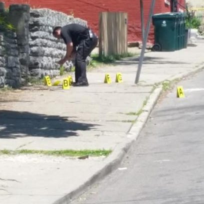 Police examine shell casings at a shooting in the 2300