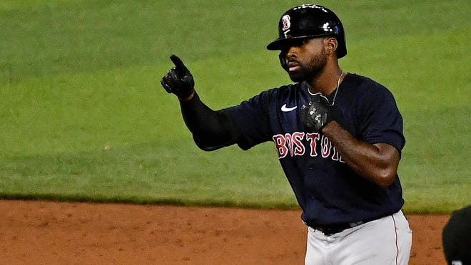 Red Sox center fielder Jackie Bradley Jr. reacts after doubling in a run during a game against the Miami Marlins last month. Bradley, known for his defense, has had a solid season at the plate this year, batting .279 with a .354 on-base percentage.