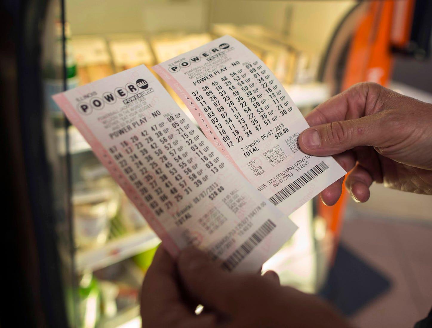 A man checks his Powerball tickets.