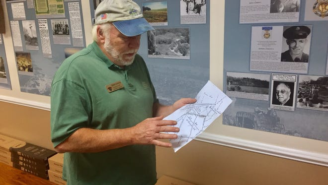 Dennis Chastain explains the significance of this plat he discovered showing the route of the Cherokee Path through Six Mile.