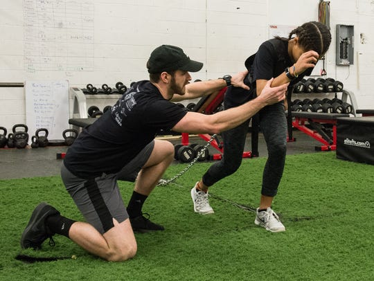 The Athlete Academy founder Cody Revel trains with an athlete on Wednesday, Jan. 31, 2018.