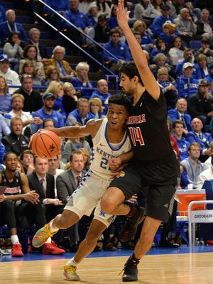 Kentucky guard Shai Gilgeous-Alexander (22) attempts to drive past the defense of Louisville forward Anas Mahmoud (14) during the first half of their game, Friday, Dec. 29, 2017 in Lexington, Ky.