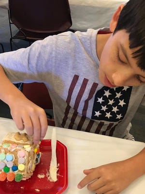 Last year at the Bastrop Public Library's annual holiday open house children decorated graham cracker houses. This year, amid the coronavirus pandemic, families will receive a kit that contains everything they need to build a house at home.