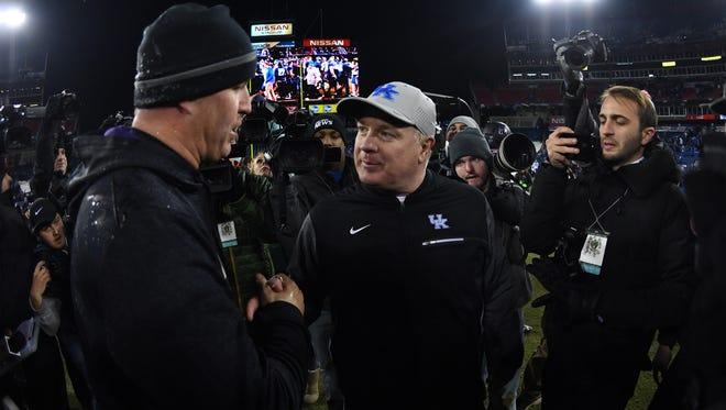 Dec 29, 2017; Nashville, TN, USA; Northwestern Wildcats head coach Pat Fitzgerald and Kentucky Wildcats head coach Mark Stoops after a Northwestern win in the 2017 Music Bowl at Nissan Stadium.