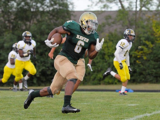 Greenfield running back Ezekiel Banks takes the opening