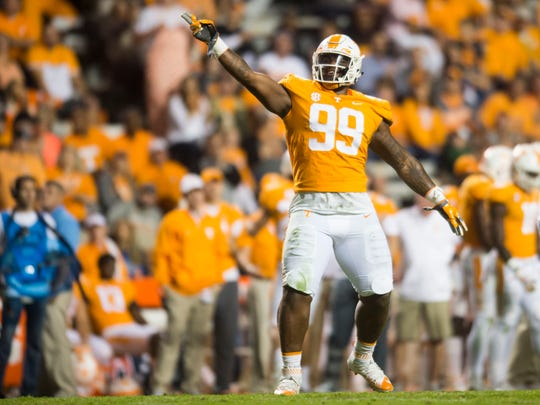 Tennessee defensive lineman Reginald McKenzie Jr. (99) celebrates after a play against Southern Miss at Neyland Stadium in Knoxville, Tennessee, on Saturday, Nov. 4, 2017.
