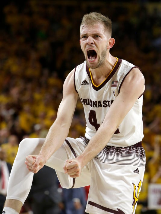 Arizona State guard Kodi Justice reacts after scoring against Arizona in the first half during an NCAA college basketball game Thursday, Feb. 15, 2018, in Tempe, Ariz. (AP Photo/Rick Scuteri)