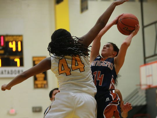 Riverside's Kayla Galindo, right, shoots against Parkland