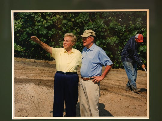 A photo of Alice and Pete Dye designing one of their golf courses hangs in the clubhouse of Crooked Stick Golf Club.