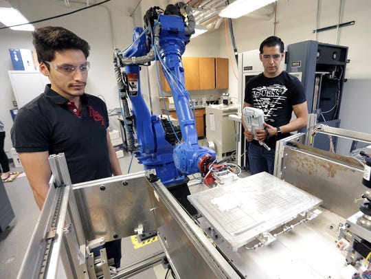 UTEP graduate engineering student Carlos Acosta, left,