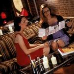 "Kristen Wiig and Jon Hamm appear in a scene from ""Friends With Kids."""