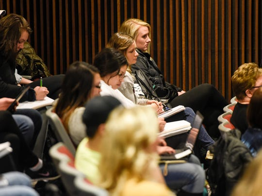 Students listen as Kari Mugo speaks during a Women on Wednesday presentation Wednesday, March 14, 2018, at St. Cloud State University.