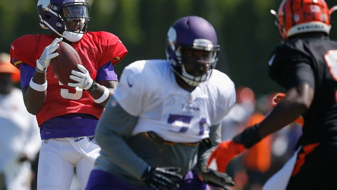 Minnesota Vikings quarterback Teddy Bridgewater (5) takes a snap during joint practice between the Minnesota Vikings and Cincinnati Bengals, Thursday, Aug. 11, 2016, on the practice fields next to Paul Brown Stadium in Cincinnati.