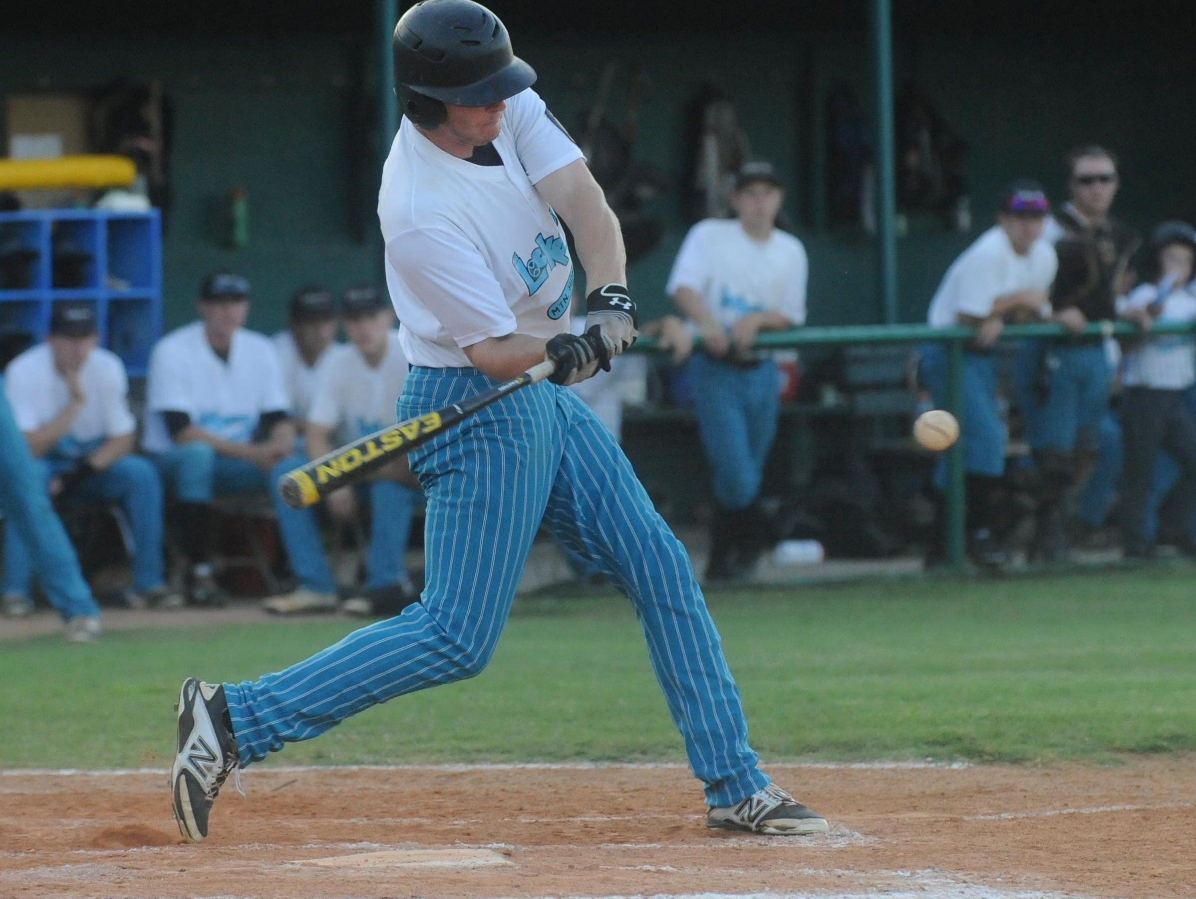 Mountain Home's Austin Jacobelli swings at a pitch during Lockeroom's 13-5 loss to the Blytheville Casons in the first round of the Zone 2 Senior American Legion District Tournament on Friday night at Cooper Park.