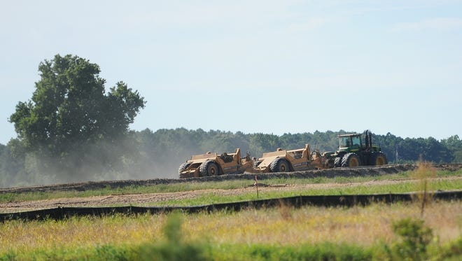 Heavy equipment at work at a poultry farm near Keller, Virginia. A comment about the poultry industry in the region at a meeting has angered Accomack supervisors.