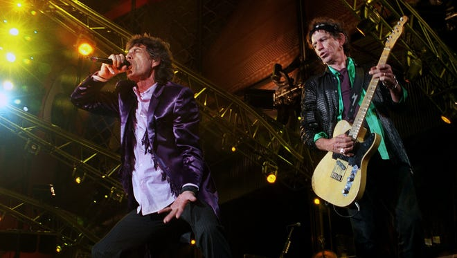 "Mick Jagger and Keith Richards perform ""Brown Sugar"" at the first Ford Field concert in 2002."