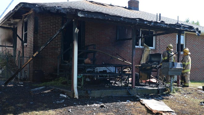 Erie firefighters battled a structure fire at 1344 W. 39th St. in Erie on Saturday. The fire damaged the backyard porch of the home and some of the first floor interior.