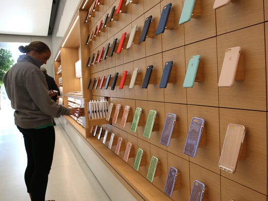A customer looks at products at the redesigned Apple