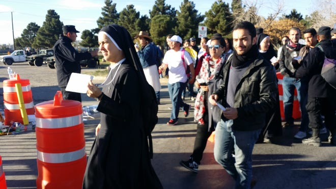 People walking to the papal Mass site in Juarez.
