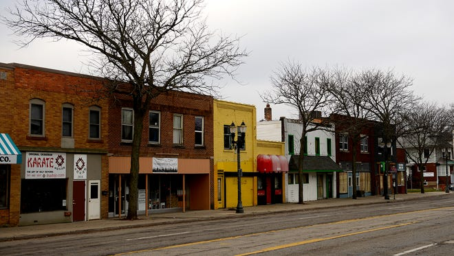 Most of the 2000 block of Michigan Avenue in Lansing will be torn down by developer Scott Gillespie, who plans on constructing a $5M four-story, mixed-use building in its place.