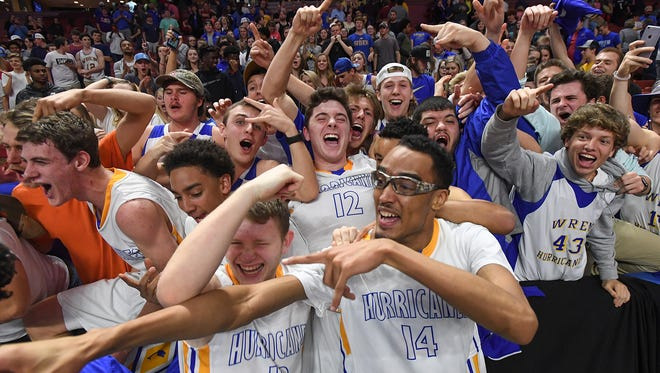 Wren players celebrates their 58-54 win over Eastside in the Class AAAA Boys Upper State Championship at Bon Secours Wellness Arena on Friday, February 24, 2017 .