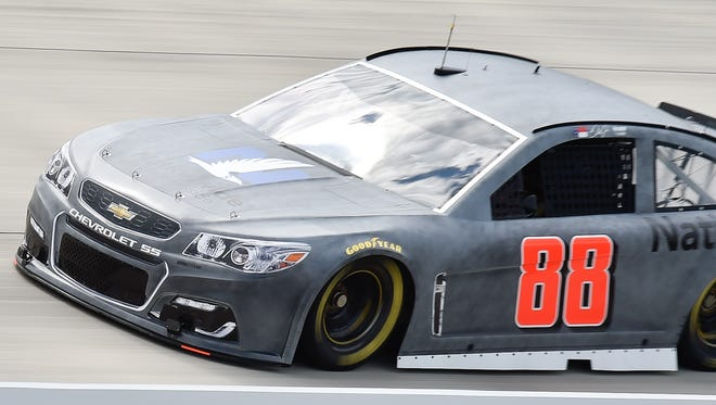 Dale Earnhardt, Jr., driver of the #88, testing his car and tires at Dover International Speedway in Dover.