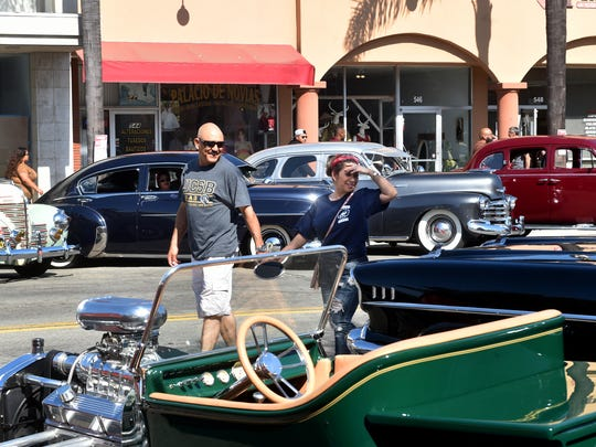 Eddie Munoz and Maria Hernandez, of Oxnard, admire classic cars along A Street in Downtown Oxnard on June 8 during the city's Cruise Night event.