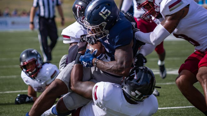 Georgia Southern running back J.D. King (15) carries the ball against Troy on Saturday at Paulson Stadium in Statesboro.