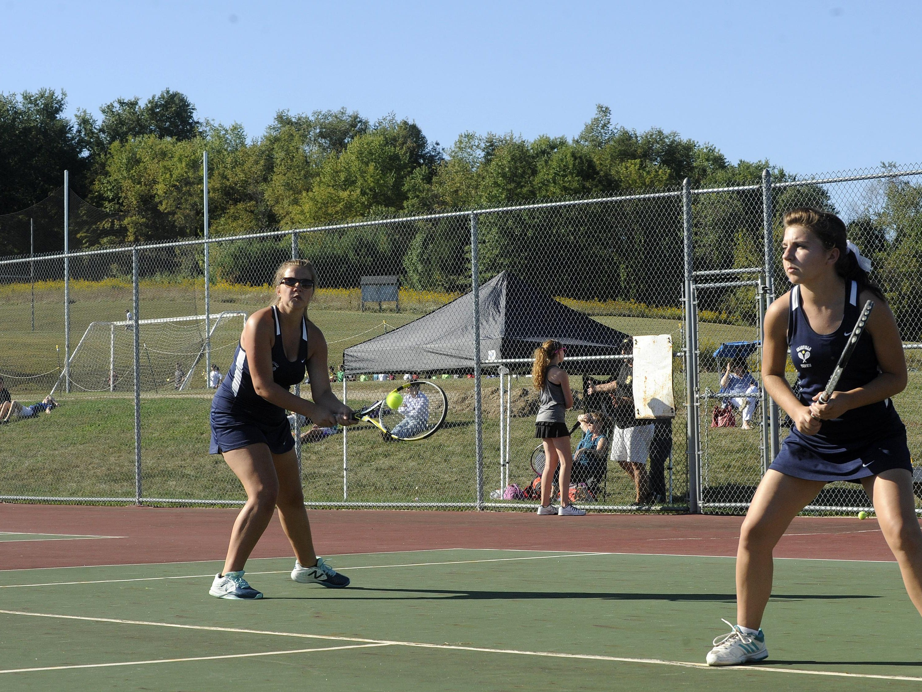 Granville senior captains Abbey Wells and Sarah Charlton play in a No. 1 doubles match against Watkins Memorial's Dolen Helwagen and Aubry Pletcher on Monday at Granville.