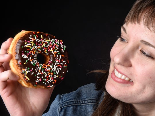 Reporter Nora Hertel admires a doughnut she's come to love through intuitive eating and recovery from bulimia.