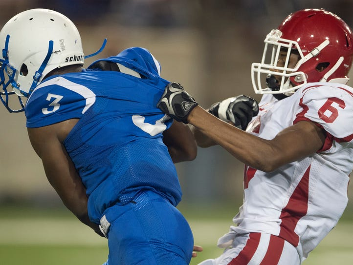 Lanier's Wda'coreyon Johnson (3) is tackled by Lee's
