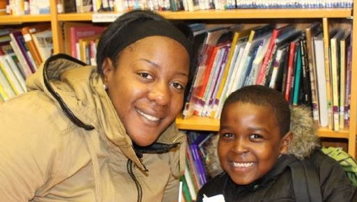 "Amir Hayes with his mother, Avenetia Hayes, attended the ""Muffins with Mom, Read with Me Breakfast."""