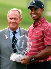 Tiger Woods holds the trophy next to Jack Nicklaus after winning the 2009 Memorial in Dublin, Ohio.(AP Photo/Mike Munden)
