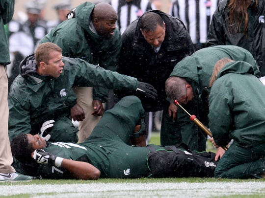 Michigan State lineman Dennis Finley is treated for a broken leg Saturday against Purdue at Spartan Stadium. Finley's injury, while the most gruesome of the season, was hardly the first. It temporarily left MSU with a mess on its offensive line.