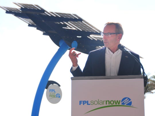 Wayne Justice, chairman of the Canaveral Port Authority, talks about the project with a solar tree in the background. Florida Power & Light has installed five solar trees at  Port Canaveral, two at Jetty park and three at Exploration Tower. A ceremony was held Wednesday morning to unveil the trees.