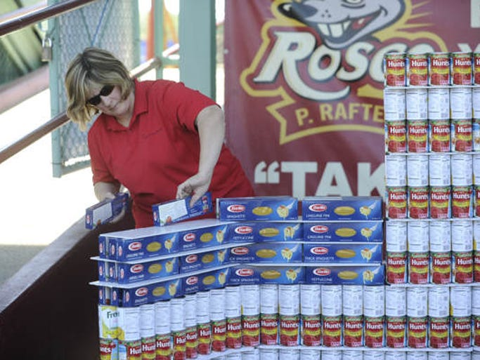 "Area teams built a variety of things out of canned goods and boxed foods, Monday, June 16, 2014,at the South Wood County Hunger Coalition'??s second annual ""??Strike Out Hunger""?? United we Can at Witter Field in Wisconsin Rapids."