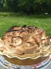 Lemon-lime pie is topped with a mound of meringue.