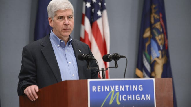 """Gov. Rick Snyder on Wednesday described the filing of criminal charges against three government workers connected with Flint's water issues as taking the crisis to a """"whole new level."""""""