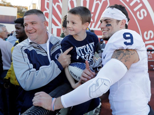 Penn State quarterback Trace McSorley poses with fans following Saturday's 45-31 victory against Indiana in Bloomington, Ind.