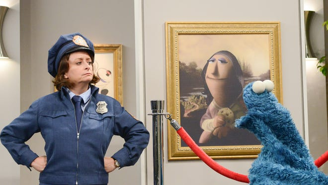 Rachel Dratch and Cookie Monster investigate a theft in  the PBS special.