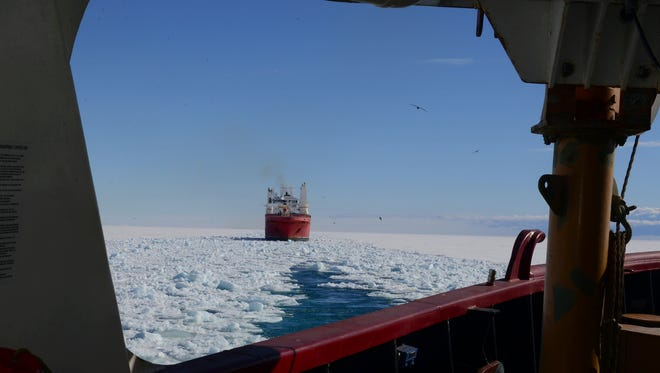 In this Jan. 26, 2015 photo, made available by the U.S. Coast Guard, the crew of the Coast Guard Cutter Polar Star opens a channel through the ice to the National Science Foundation's McMurdo Station, Antarctica, for the supply ship Ocean Giant. Solar Star's crew is aiding in the rescue of the Australian boat Antarctic Chieftain that suffered damage to three of its four propellers after getting stuck Wednesday Feb. 11, 2015, and can no longer maneuver. (AP Photo/U.S. Coast Guard, Petty Officer 1st Class George Degener)
