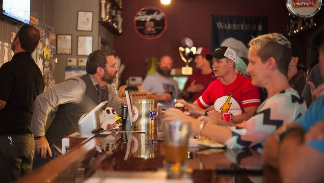 Guests won't be able to sit at the bar with the Village Idiot Pub in Cocoa Village, but owner Jason Estes is thrilled to reopen the bar on Friday.