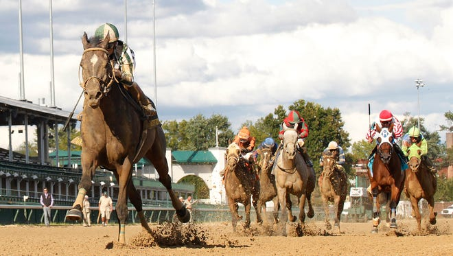 Frivolous, ridden by Jon Court, romped to an eight-length victory in Saturday's Locust Grove at Churchill Downs.