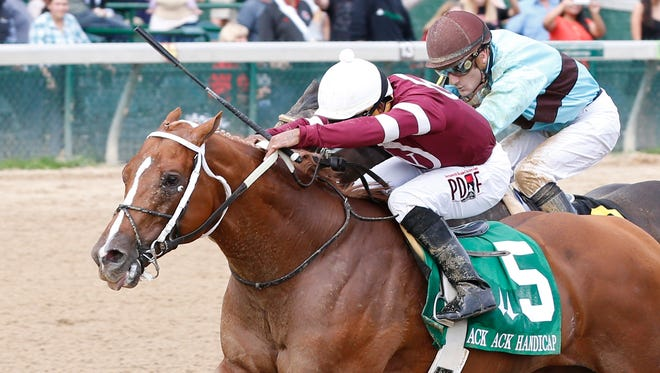 Tapiture and Ricardo Santana Jr. held off Viva Majorca and Julien Leparoux to win the Grade III Ack Ack Saturday at Churchill Downs.