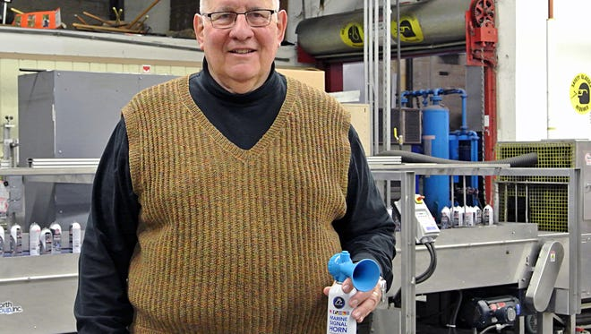 Phil Lapin, president of Falcon Safety Products, is pictured in the company's Branchburg manufacturing facility with its safety horn for hunters, hikers, fishermen and campers.