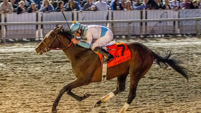 Mo Tom, Corey Lanerie aboard, ran late to win Saturday's Grade III LeComte at Fair Grounds.