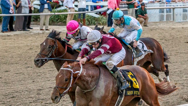 Gun Runner, inside, beat Forevamo and late-running Mo Tom to the wire in Saturday's Risen Star Stakes at Fair Grounds.