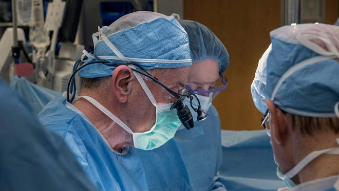 A team of Cleveland Clinic transplant surgeons and gynecological surgeons perform the nation's first uterus transplant during a nine-hour surgery in Cleveland on Feb. 24, 2015.