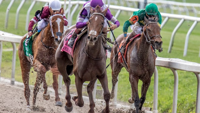 Land Over Sea wins the 49th running of the Twinspires.Com Fair Grounds Oaks (Grade II) at the Fair Grounds Race Course in New Orleans.